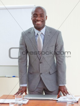 Attractive Afro-American businessman in office