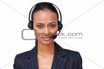 Beautiful ethnic businesswoman with a headset on