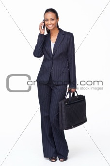 Beautiful businesswoman on phone holding a biefcase