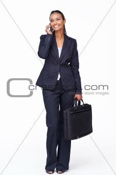 Beautiful businesswoman on phone after work