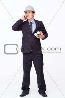 Attractive architect on mobile phone holding plans
