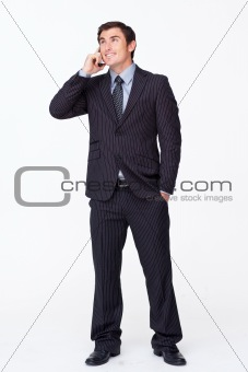 Attractive businessman on mobile phone against white