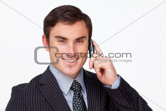 Portrait of an attractive businessman on phone against white
