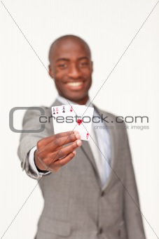 Attractive Afro-American businessman holding four aces
