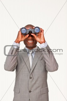 Afro-American businessman looking through binoculars