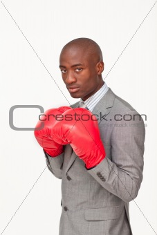 Afro-American businessman with boxing gloves