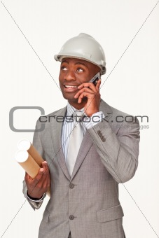 Smiling Afro-American architect speaking on mobile phone