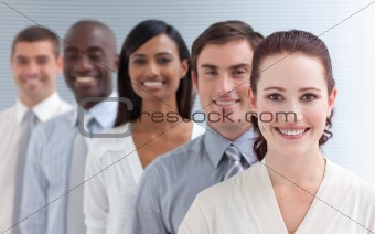 Business team in a line. Focus on a beautiful woman