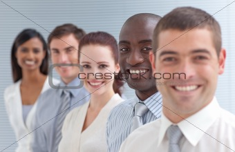 Business people in a line. Focus on an ethnic man