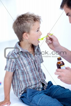 Child taking cough medicine