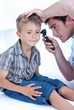 Doctor examining a patient&#39; s ears with a otoscope