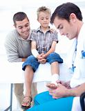Doctor bandaging a child&#39;s foot