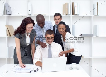 Business team working together with a laptop