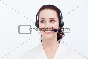 Beautiful businesswoman with a headset on looking upwards