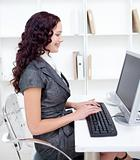 Young businesswoman working in office with a computer