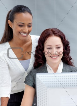 Beautiful businesswomen using a computer