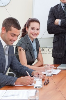 Business people in a meeting with their manager