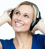 Portrait of a woman listening to music with headphones on