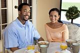 Happy African American Couple Sitting Outside Having A Healthy B