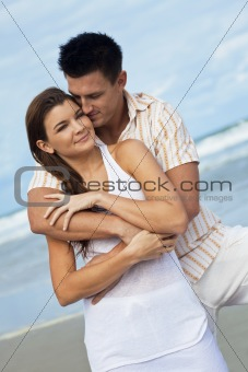 Man and Woman Couple In A Romantic Embrace On Beach