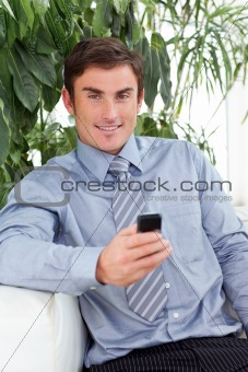 Attractive businessman writing a message