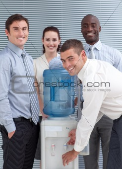 Busines people standing around water cooler