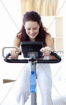 Beautiful woman doing spinning at home