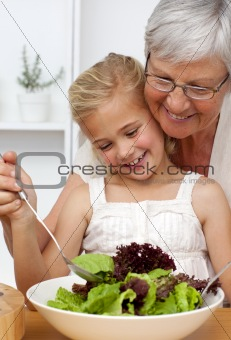 Happy grandmother cooking