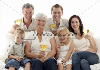 Portrait of family drinking wine and children eating biscuits