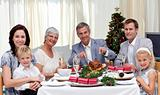 Family eating turkey in Christmas Eve Dinner