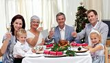 Family celebrating Christmas dinner with turkey at home