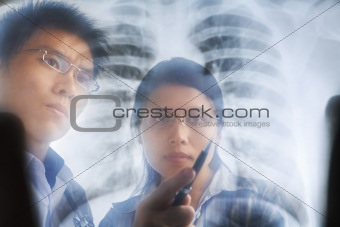 Asian doctors having discussion over xray print