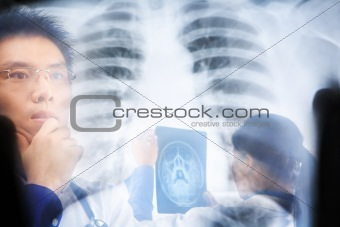 Asian doctors busy working