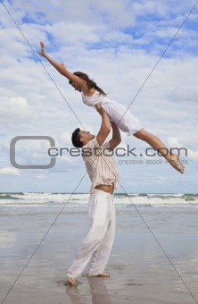 Yong Man and Woman Couple, Jumping in Celebration On Beach