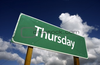 Thursday Green Road Sign with dramatic blue sky and clouds - Days of the Week Series.