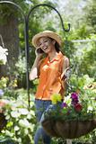 Young Woman With Cell Phone in Garden