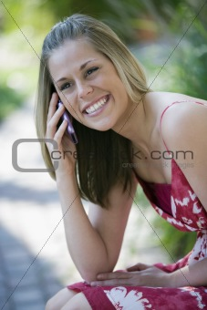 Smiling Woman Outdoors with Cell Phone