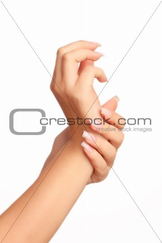 Beautiful woman hands with manicure isolated on white background