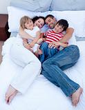 High view of family relaxing in bed