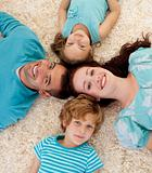 Happy family on floor with heads together