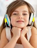 Smiling girl lying in bed listening to the music