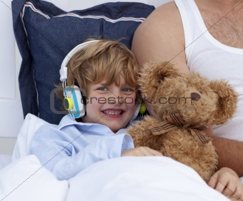 Boy listening to music in bedroom