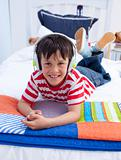 Portrait of boy on headphones listening to music in bed