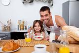 Daughter having breakfast with her father