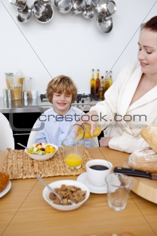 Boy having breakfast with his mother