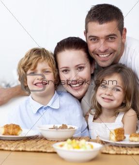 Portrait of happy family having breakfast