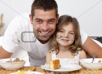 Portrait of father and daughter having breakfast