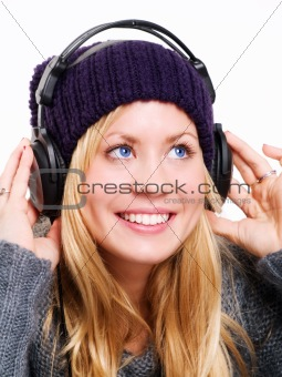 closeup of smiling beautiful teenager with headphones listening