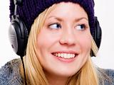 closeup of smiling beautiful teenager with headphones