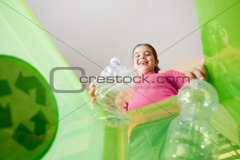 Girl recycling plastic bottles